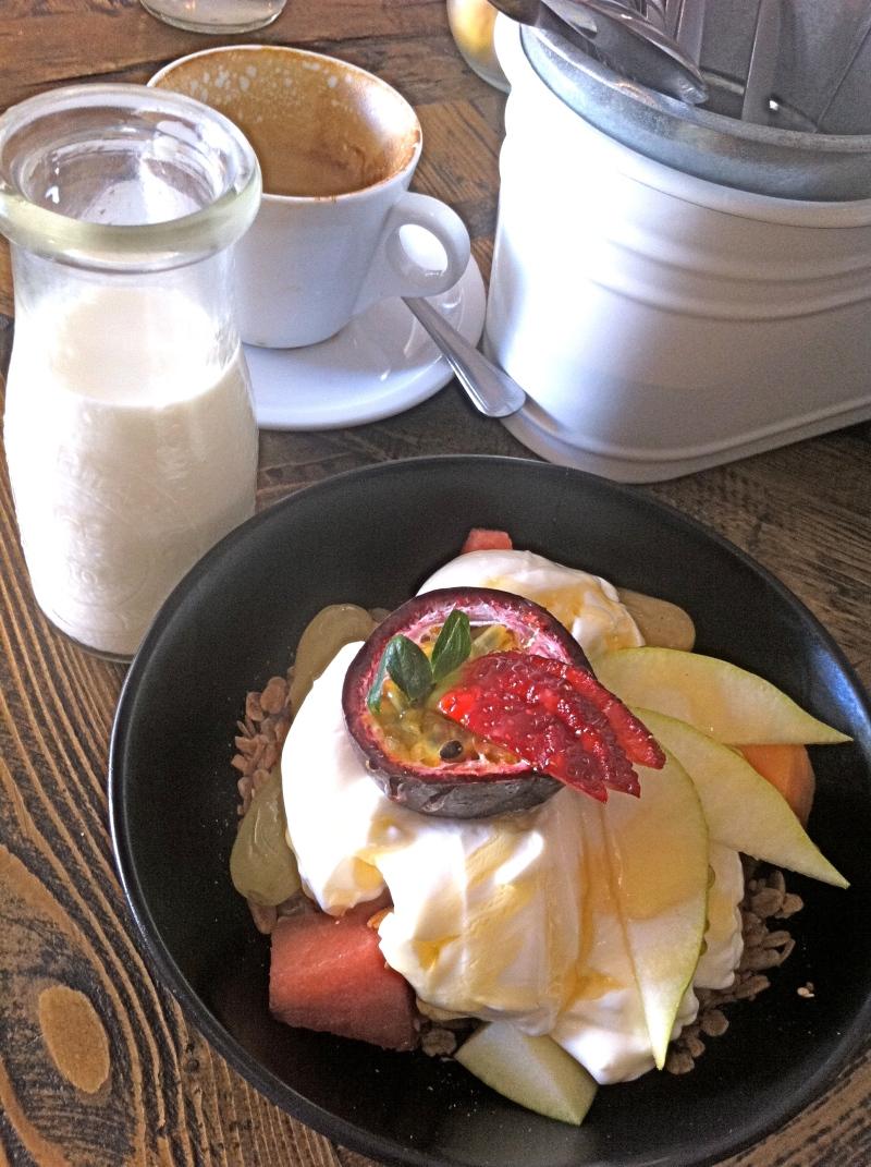 Passionfruit, melon, yoghurt, strawbs over muesli