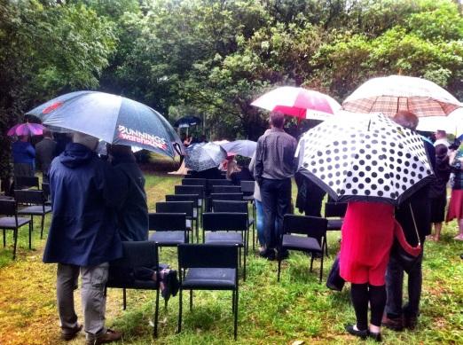 Bride & Groom through umbrellas