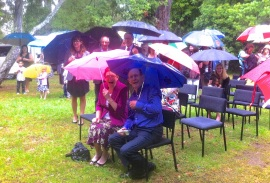 The Groom's relatives under umbreelas