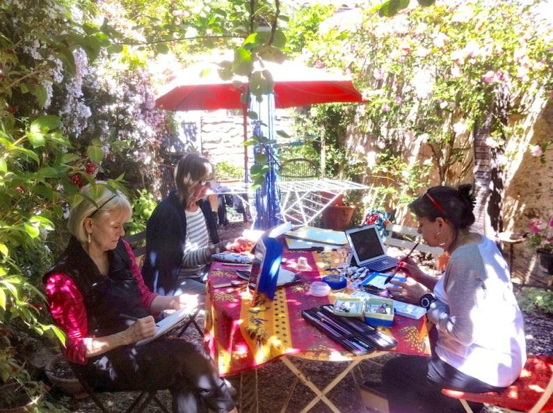 3 painter girls working in La Bergerie Garden